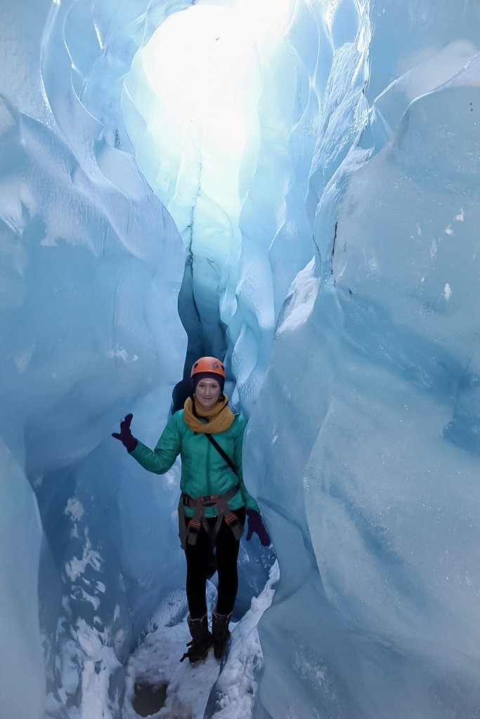Hiking inside of a glacier in Iceland - plan what to pack in Icelands