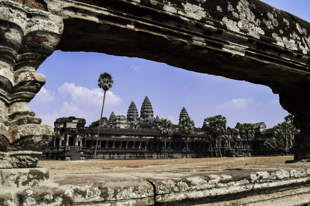 A photo of the Angkor Wat Ruins with a blue sky.