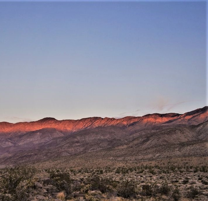 Anza Borrego at sunset with golden light on the mountains.
