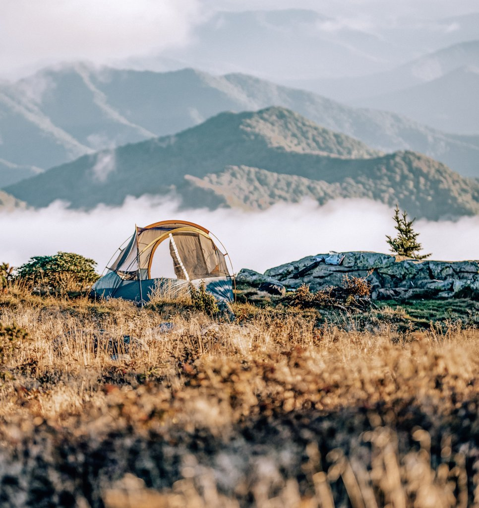 A tent near the mountains, to camp solo as a bucket list idea