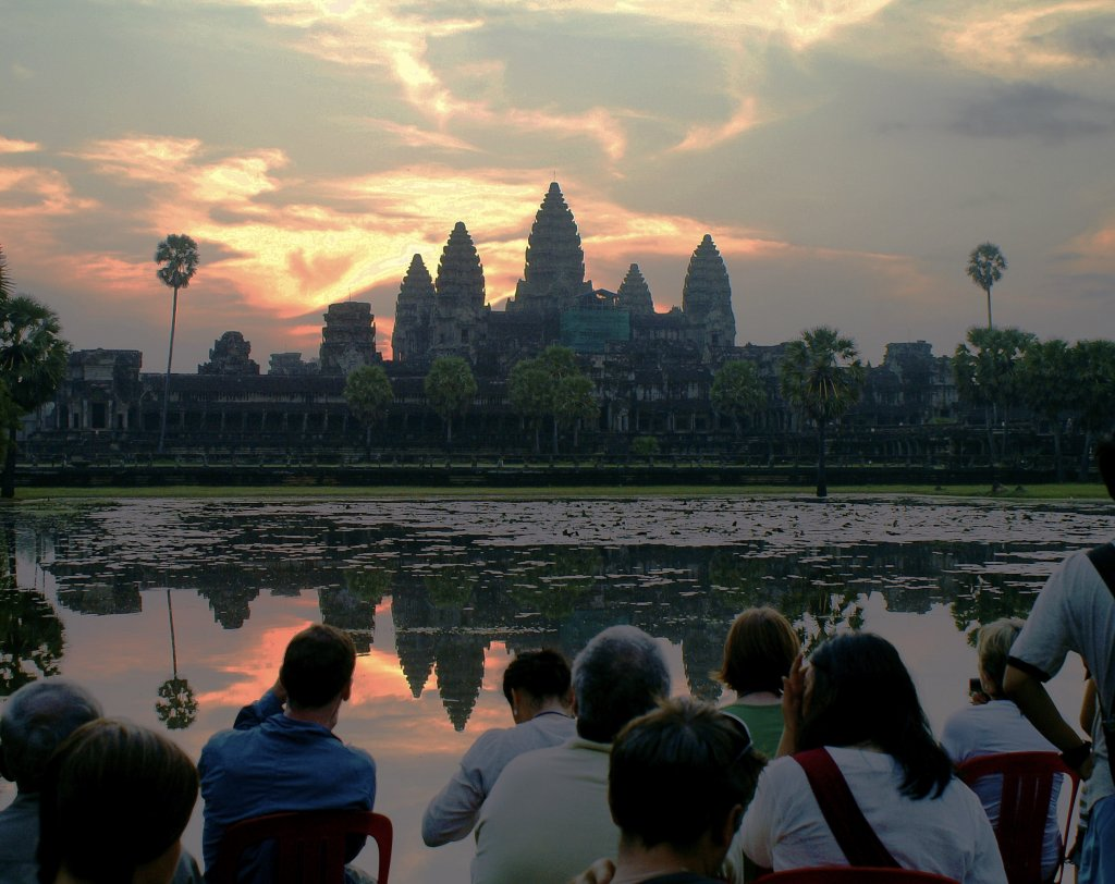 A group of photographers during sunrise at Angkor Wat.