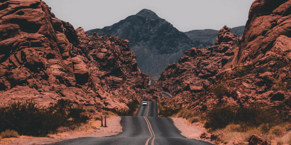 Valley of Fire State Park road with jagged mountains.
