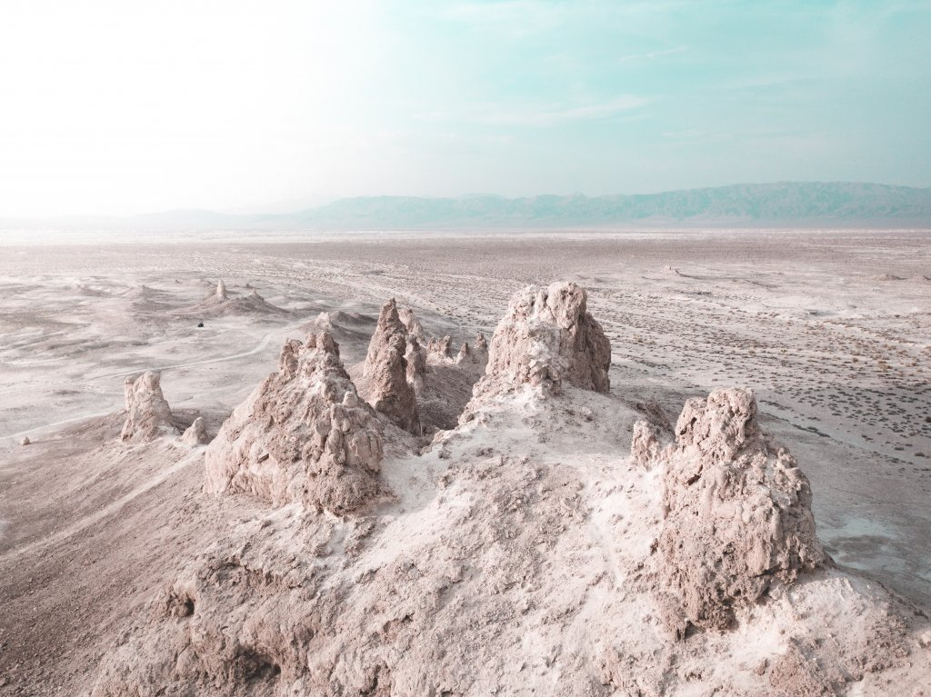 A view of the Trona Pinnacles with mountains in the background.