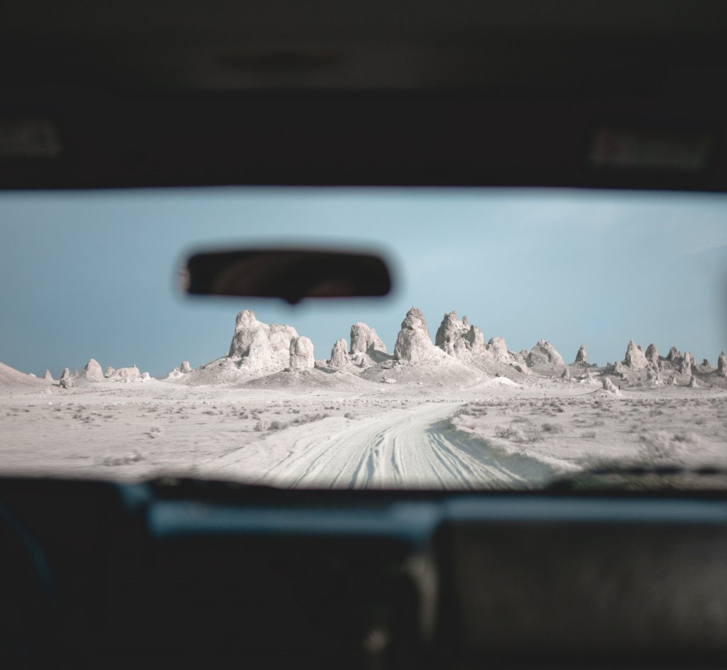 The rocks standing tall, looking through a car windshield.