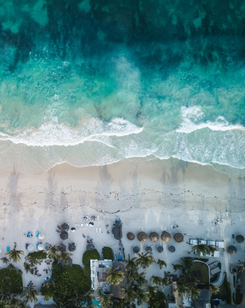 An aerial view of the beach in Quintana Roo -, comparing Los Cabos or Cancun beaches.