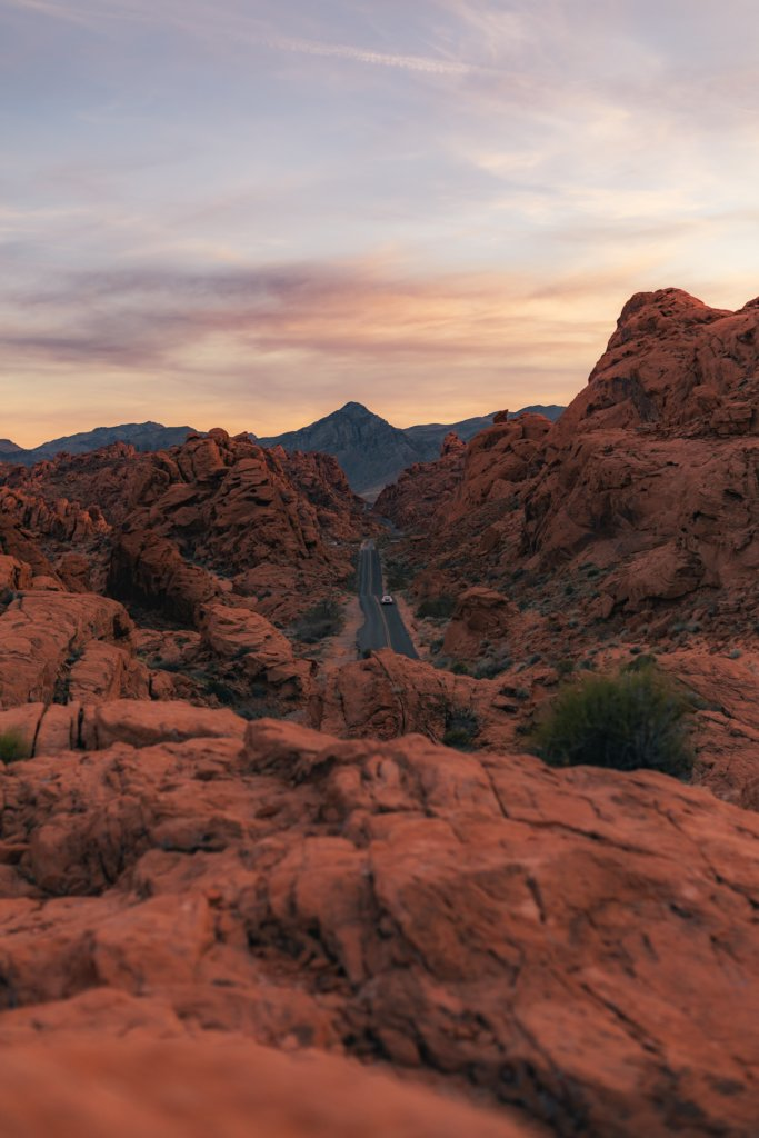 A view of the Valley of Fire State Park red rocks and winding road.