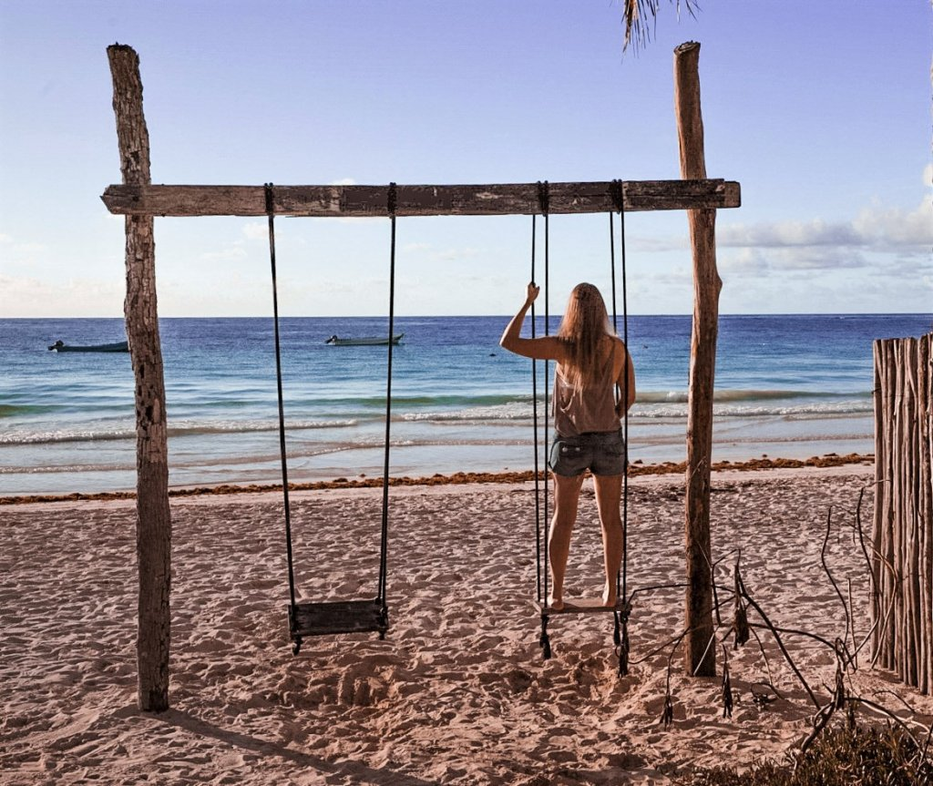 Monica on a swing on Paradise Beach - one of the best Things to Do in the Yucatan Peninsula.