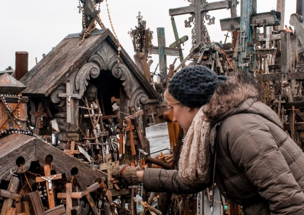 Monica placing a cross at the Hill of Crosses Lithuania.