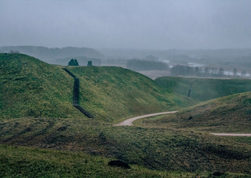 Fog over the hills of Kernave - one of my top recommendations on places to visit in Lithuania.
