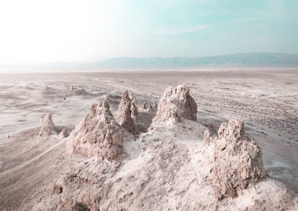 The trona pinnacles in the Mojave Desert,  in front of a sunny sky.