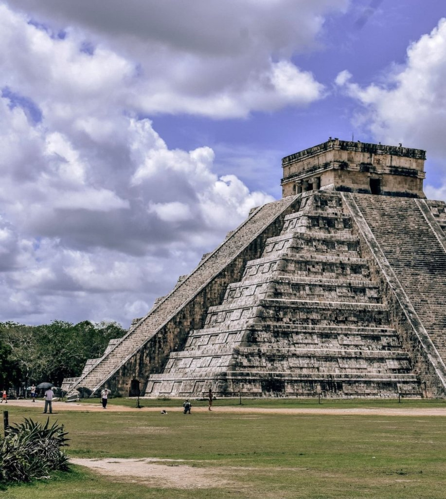 Things to Do in the Yucatan Peninsula 2 - Go to Chichen Itza.  Mayan ruins and blue sky.