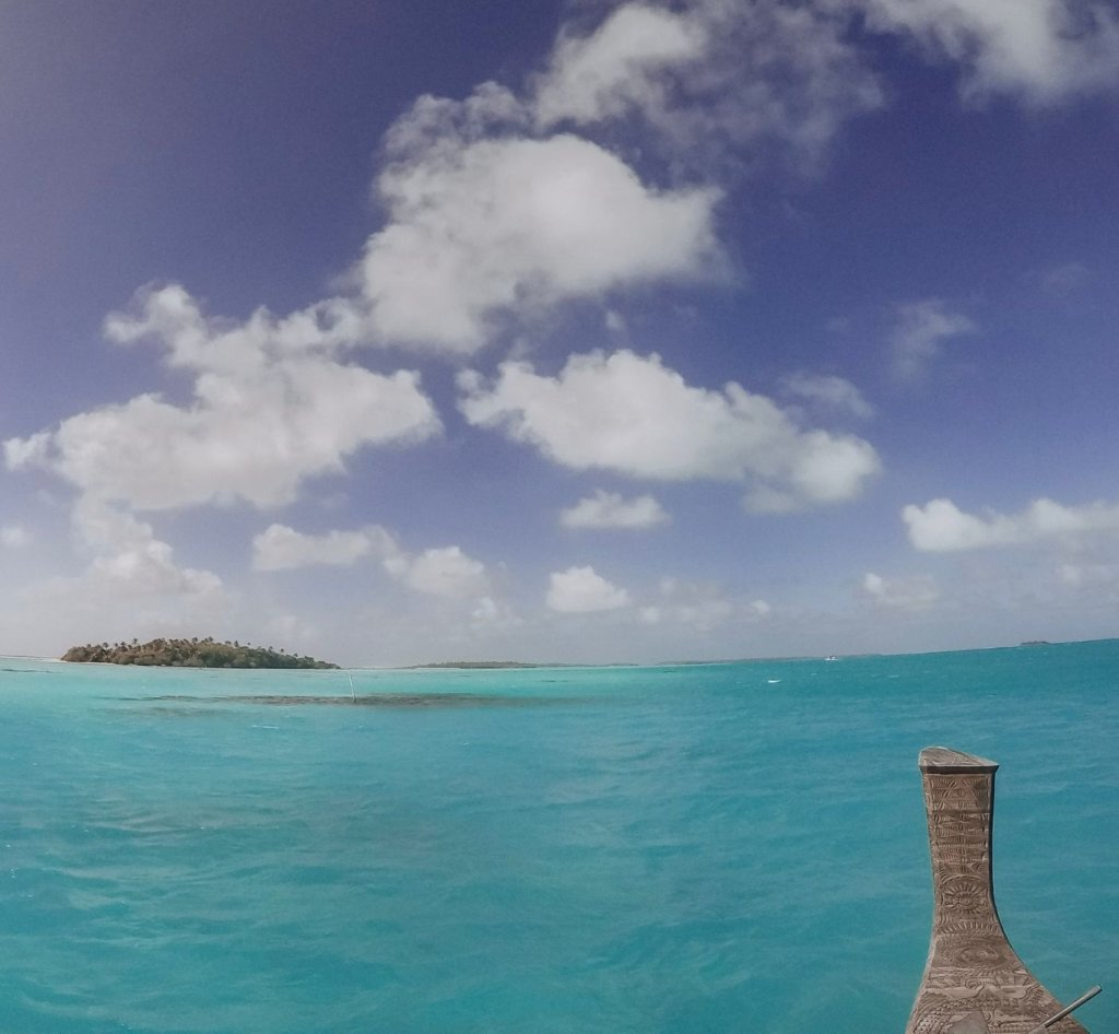Blue skies and an island in the distance in the Cook Islands, on the Vaka Cruise.