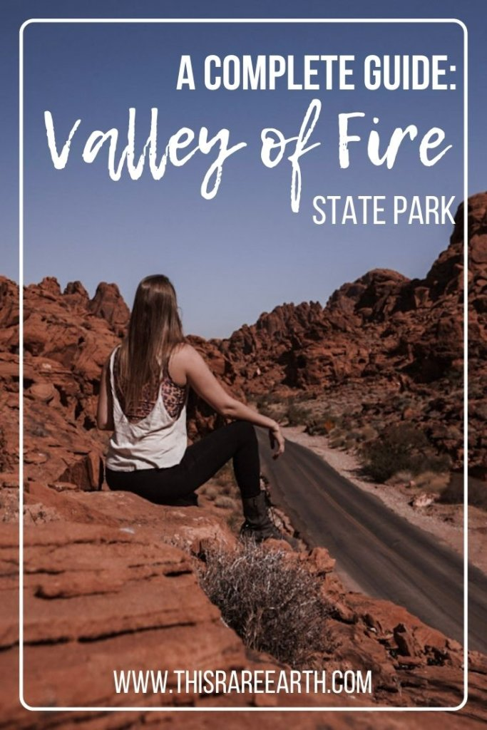 Valley of Fire State Park Complete Guide Pin.  Overlooking jagged mountains.