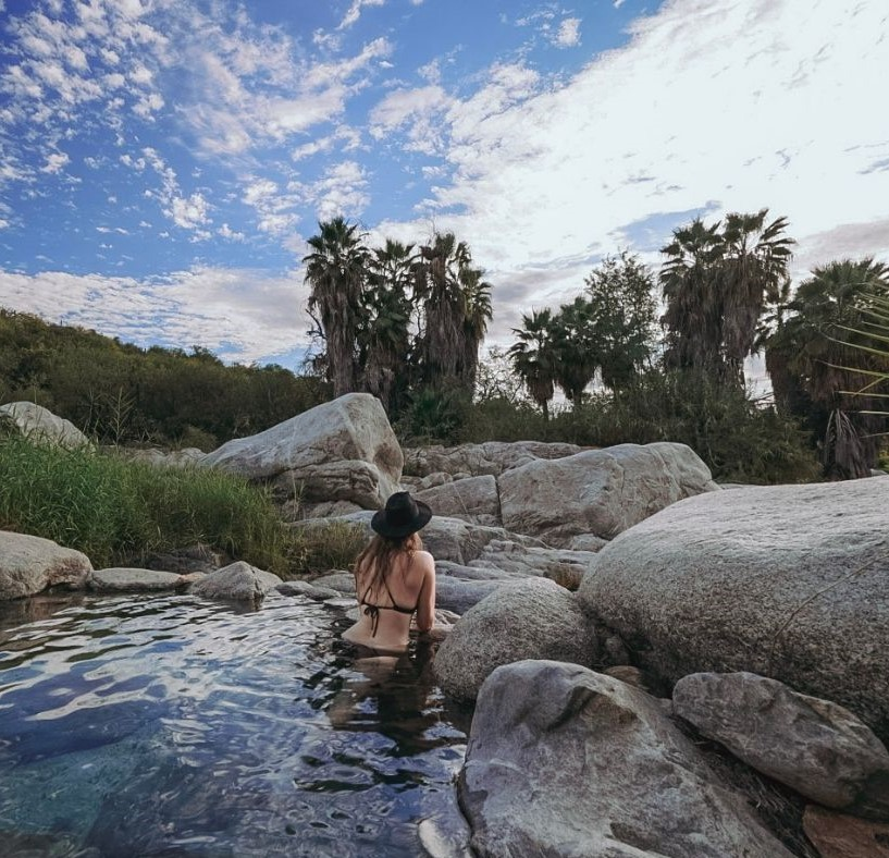 Monica in the hot springs in the Sierra de la Laguna mountains, which is stop #3 on your road trip in Baja.