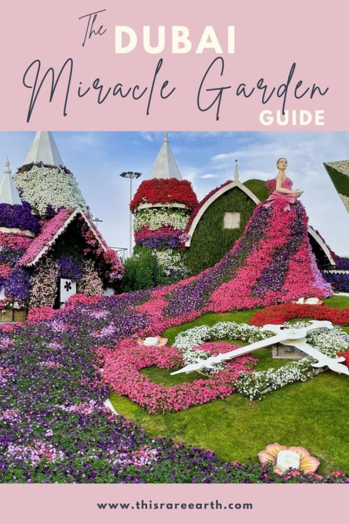 Dubai Miracle Garden Guide Pin with pink, red and white flowers.