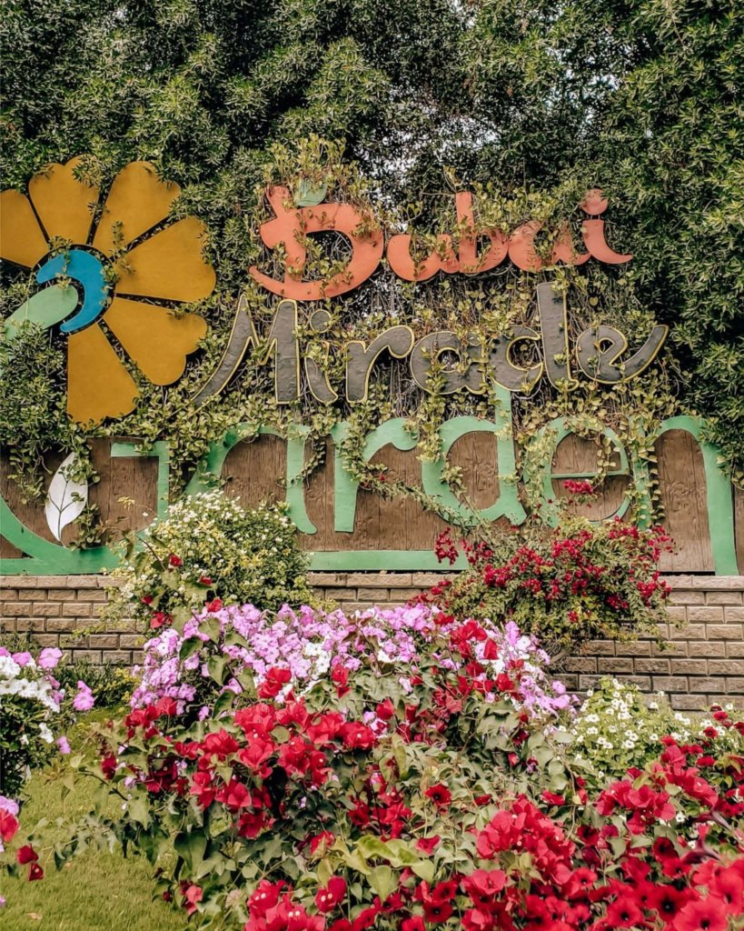 "The ""Dubai Miracle Garden"" entrance sign."