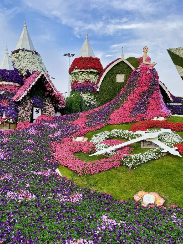 Bright pink, purple and red flower sculptures at the Dubai Miracle Gardens.