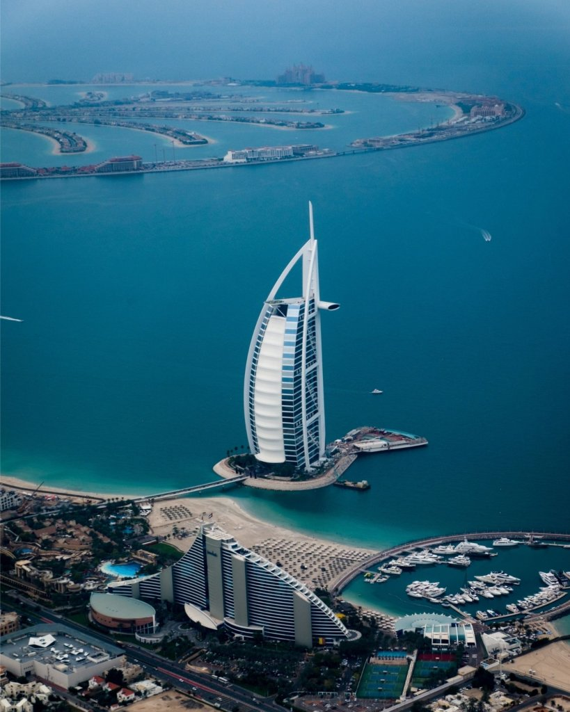 The Burj al Arab with the palm-shaped island in the background.