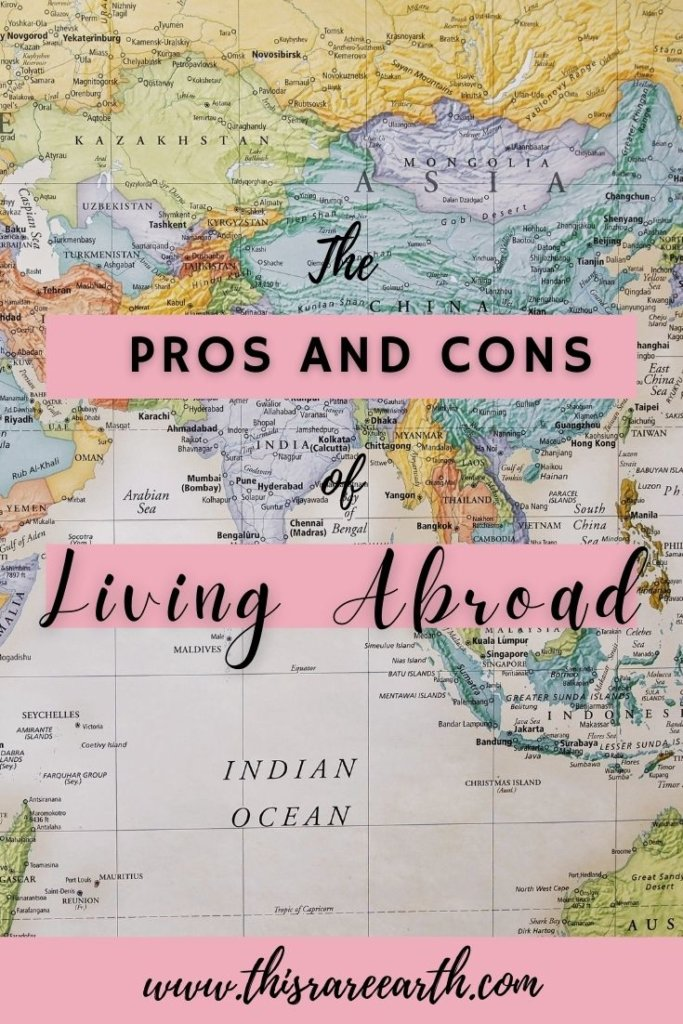 The Pros and Cons of Living Abroad Pin with world map.