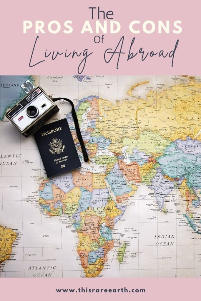 The Pros and Cons of Living Abroad Pin with map, camera, and passport.