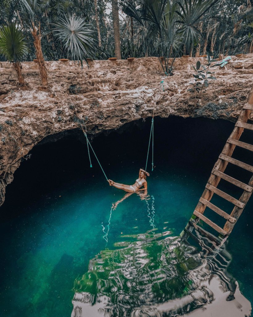 Monica lounging near the turquoise waters of Cenote Calavera.