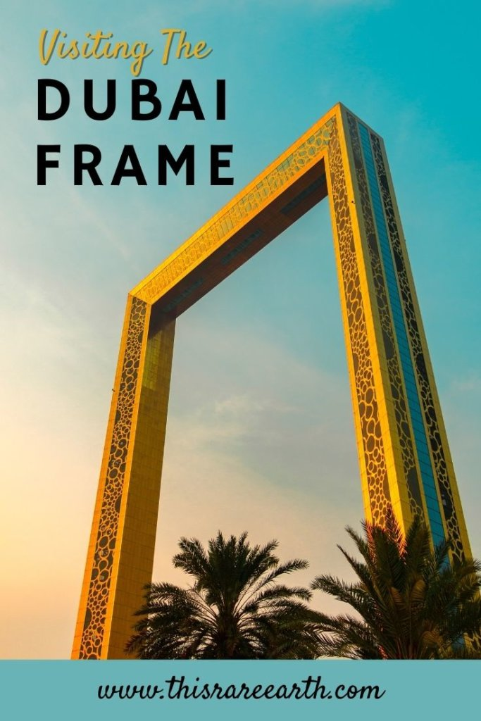 The Golden Frame in Dubai with pink skies and palm trees.