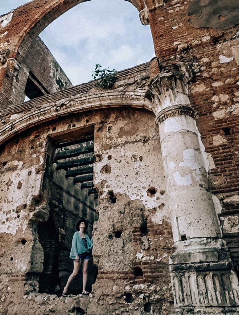 Monica exploring the ruins in Santo Domingo, on a solo female travel expedition.