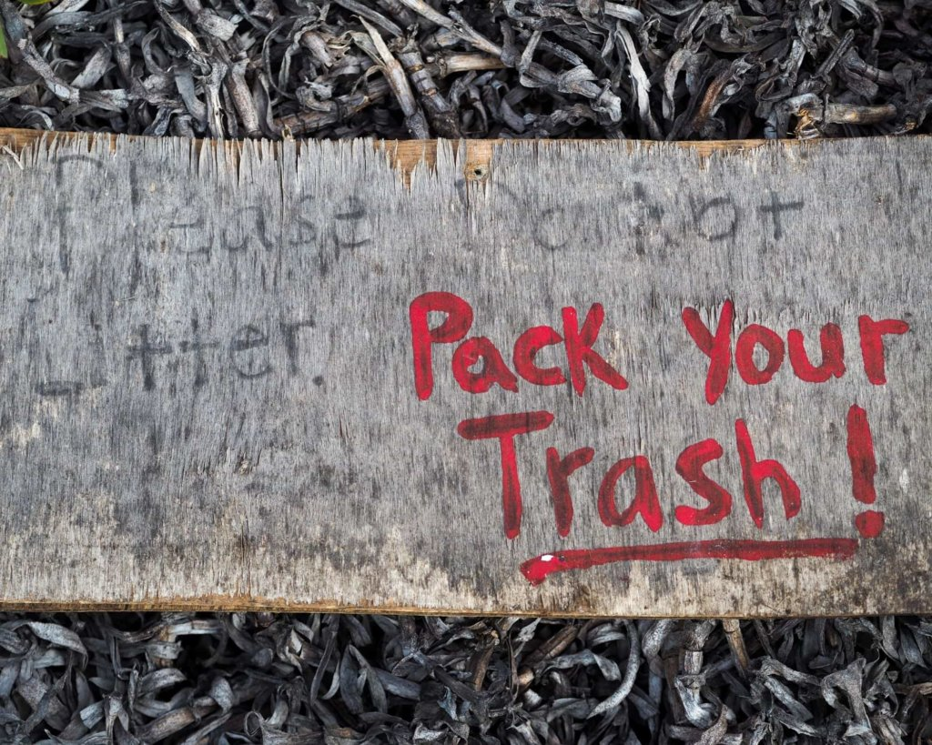"""A sign reading """"Pack your trash!"""""""