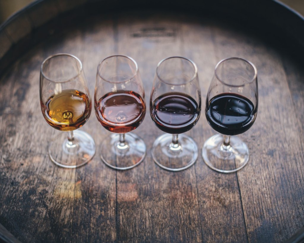 4 wines lined up for tasting in Temecula - one of the Cheap Weekend Getaways in California.