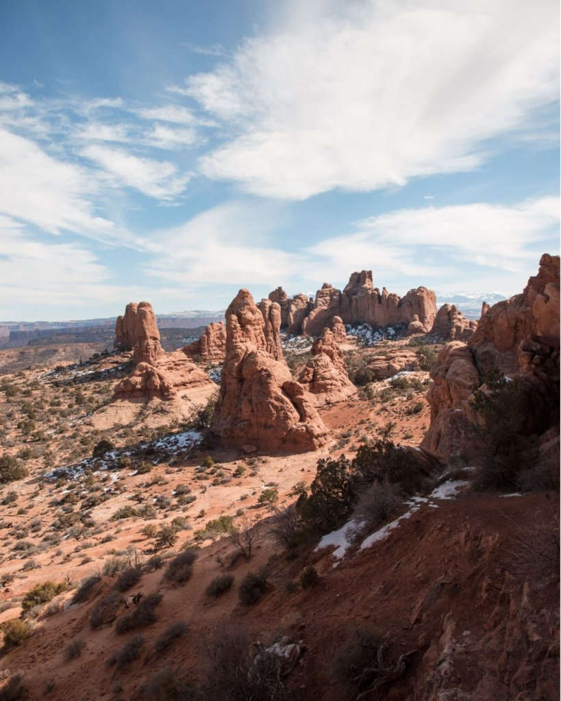 A stunning view of rocks jutting up from soil in Arches.