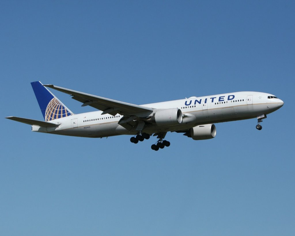 United Airlines flying in blue sky.