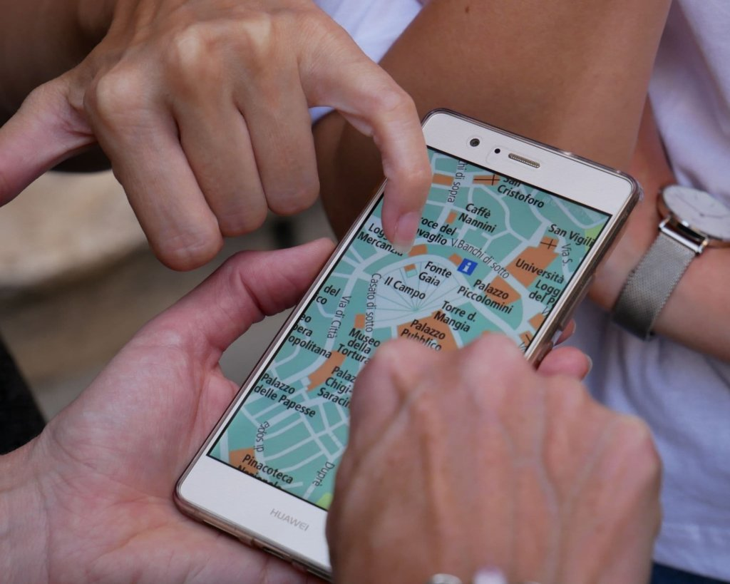 Several people checking the map on Google Maps.