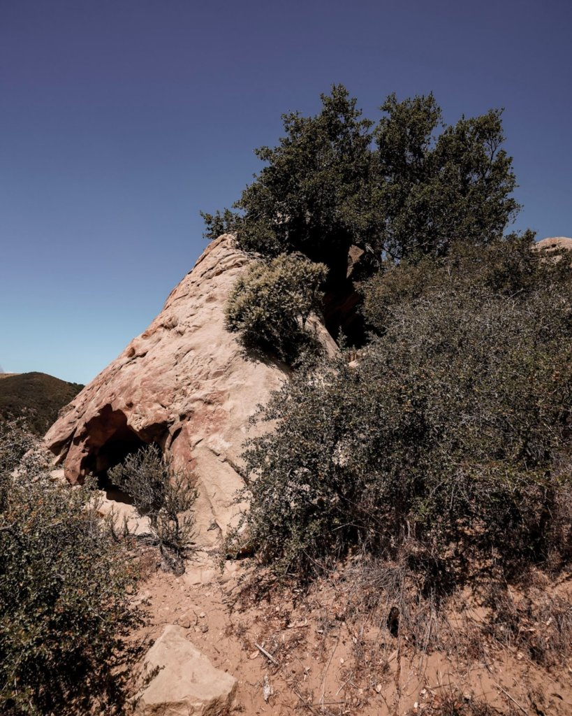 The Gaviota Wind Caves in front of blue sky.