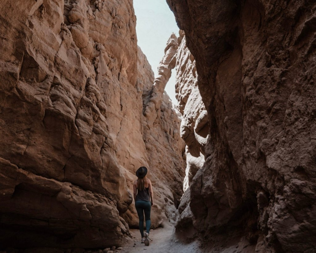Monica looking up at the natural bridge on the Slot Canyon hike in Anza Borrego.