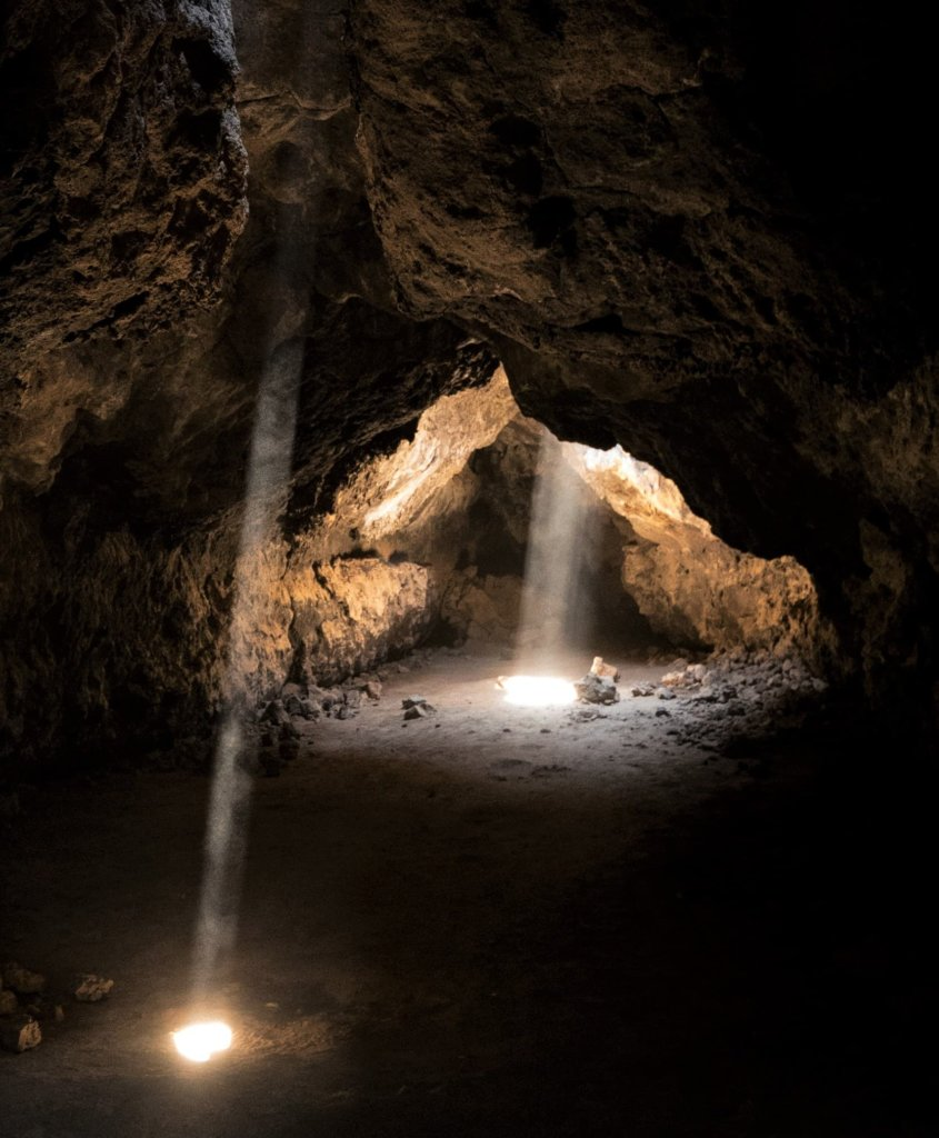 The Mojave National Preserve Lava Tubes with light streaming in through the ceiling.