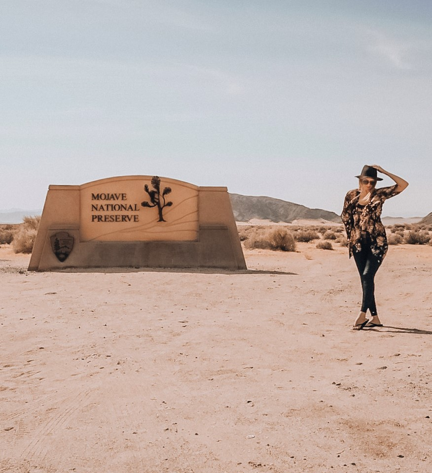 Monica at the Mojave National Preserve entrance sign.