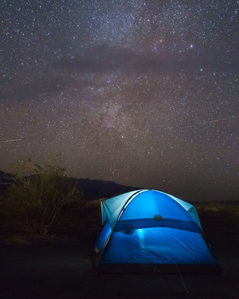 Camping in Death Valley with a bright blue tent.